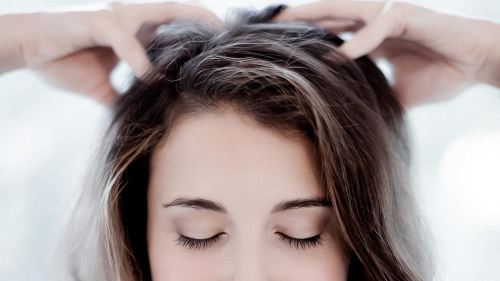 girl giving herself a scalp massage