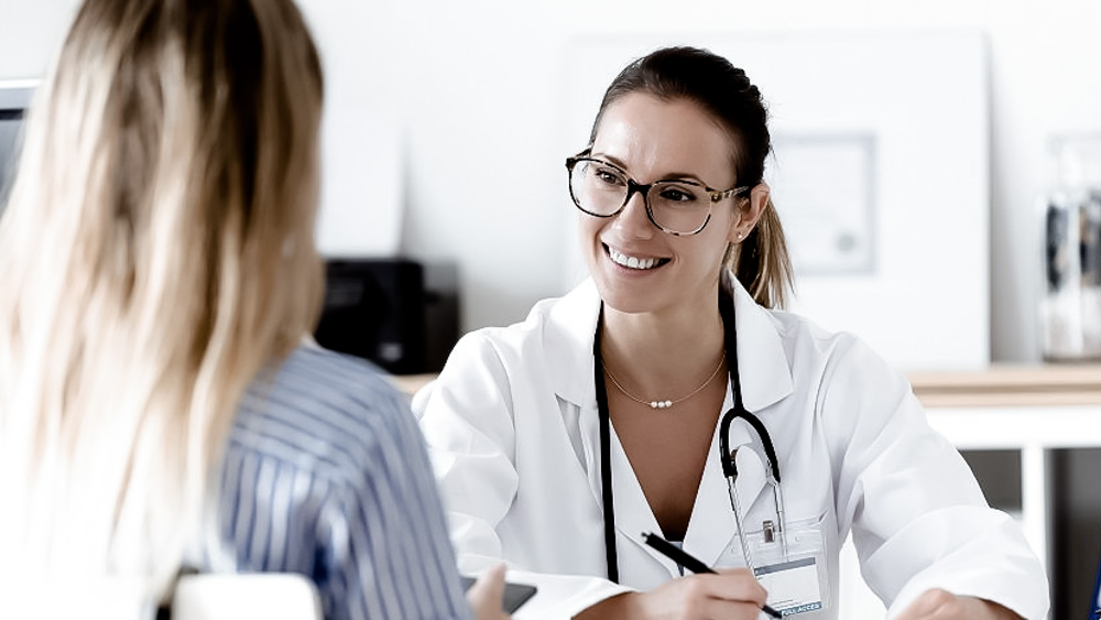 girl at check up with doctor